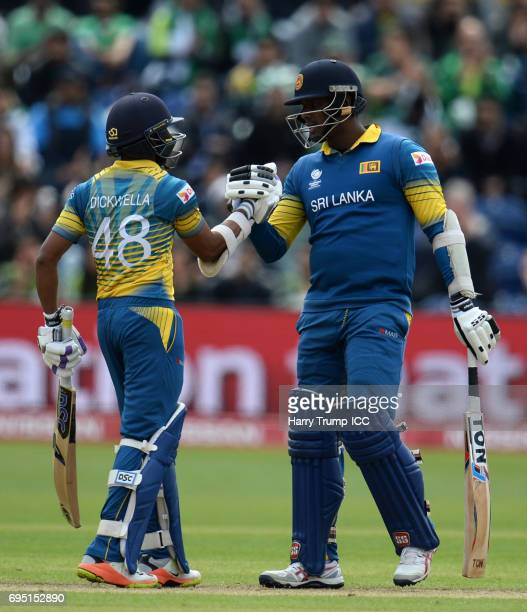 Niroshan Dickwella of Sri Lanka celebrates his half century with Angelo Matthews of Sri Lanka during the ICC Champions Trophy match between Sri Lanka...