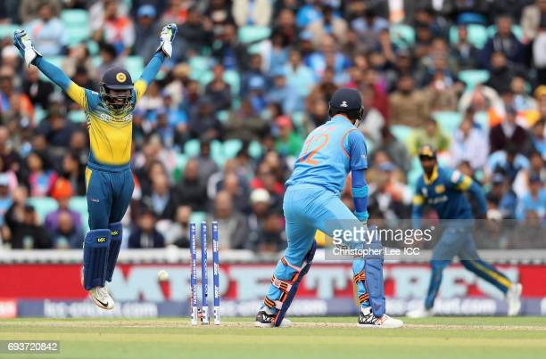 Niroshan Dickwella of Sri Lanka celebrates the wicket of Yuvraj Singh of India during the ICC Champions Trophy Group B match between India and Sri...