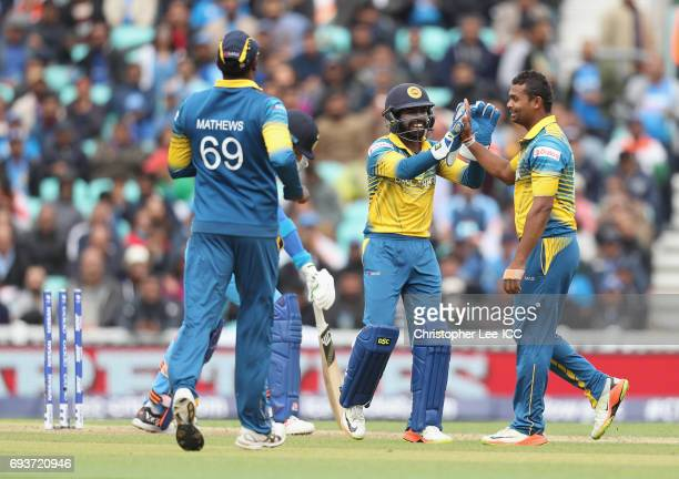Niroshan Dickwella of Sri Lanka celebrates the wicket of Yuvraj Singh of India with bowler Asela Gunaratne during the ICC Champions Trophy Group B...