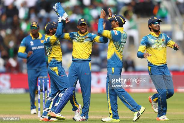 Niroshan Dickwella of Sri Lanka celebrates with team mates after taking a catch off the bowling of Nuwan Pradeep to dismiss Imad Wasim of Pakistan...