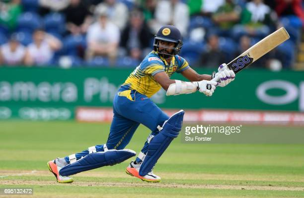 Niroshan Dickwella of Sri Lanka hits out during the ICC Champions League match between Sri Lanka and Pakistan at SWALEC Stadium on June 12 2017 in...