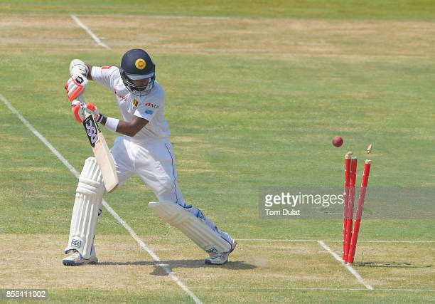 Niroshan Dickwella of Sri Lanka is being dismissed by Hasan Ali of Pakistan during Day Two of the First Test between Pakistan and Sri Lanka at Sheikh...