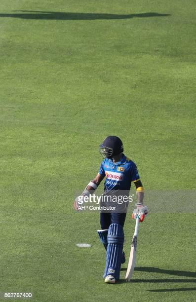 Niroshan Dickwella of Sri Lanka leaves the field during the third one day international match between Pakistan and Sri Lanka in Abu Dhabi at Zayed...