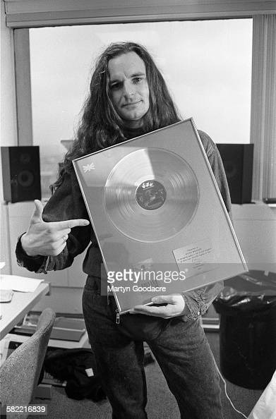 Nirvana's UK publicist Anton Brookes of Bad Moon PR holding a gold disc from EMI for 100000 sales of the band's album 'Nevermind' United Kingdom 2000