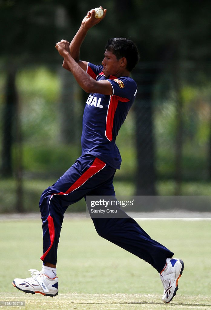 Nischal Pandey of Nepal bowls during the ACC U-19 Elite Cup Semi Final against UAE at the Bayuemas Cricket Ground on May 10, 2013 in Kuala Lumpur, Malaysia.