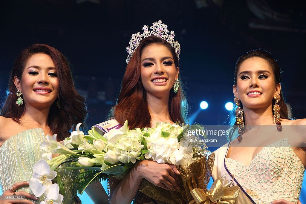 Nissa Katerahong, the winner of the Miss Tiffany's Universe transgender beauty contest, poses for pictures with the two runners up during The Miss Tiffany Universe contest 2014 in Pattaya. This year marked the 40th anniversary of the Tiffany's show in Pattaya and this was the 16th Miss Tiffany Universe contest with all of the transsexual or transvestite contestants, aiming to promote human rights for the trans-gender population in Thailand.