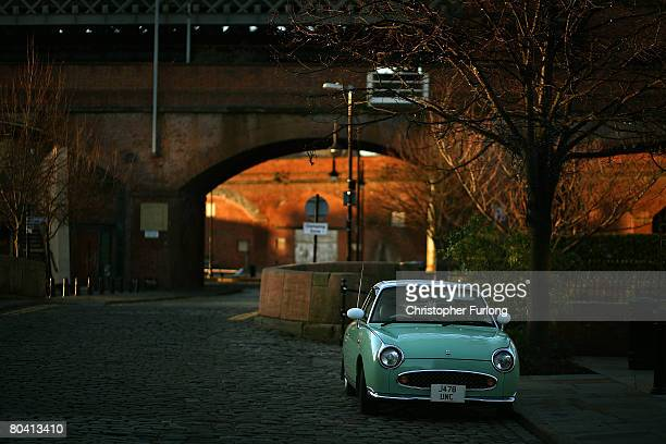 Nissan Figaro car sits on the cobblestones of the Castlefield conservation area of Manchester England on March 27 The regeneration of Greater...