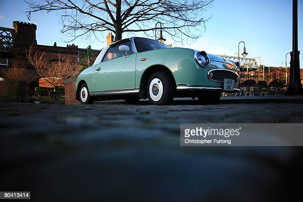 A Nissan Figaro car sits on the cobblestones of the Castlefield conservation area of Manchester England on March 27 The regeneration of Greater...