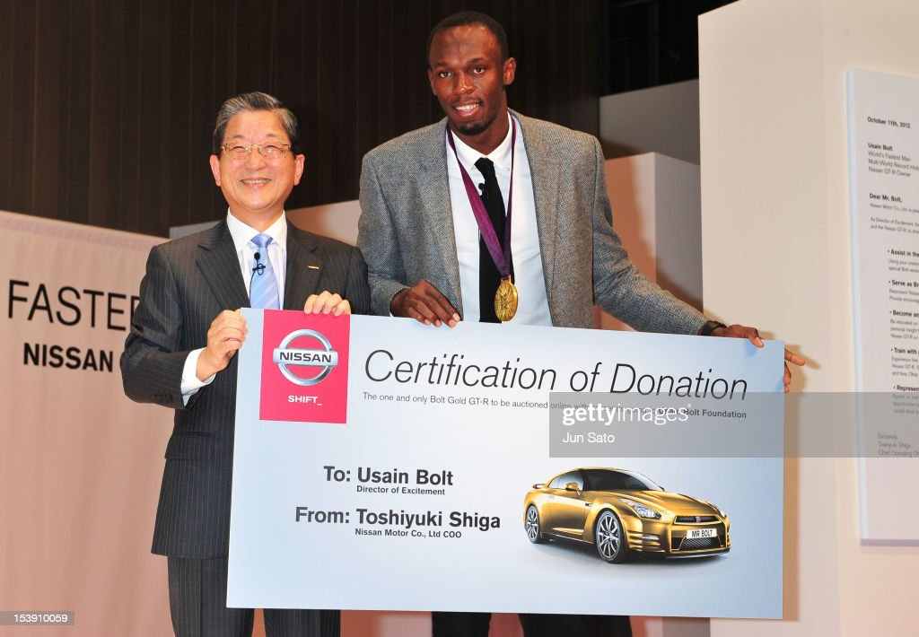 Nissan Morter Co Ltd COO Toshiyuki Shiga and Usain Bolt attend the Nissan GTR promotional event at Nissan Global Headquarters on October 11 2012 in...