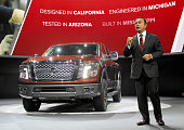 Nissan Motor Co CEO Carlos Ghosn introduces the new 2016 Nissan Titan XD truck at the North American International Auto Show on January 12 2015 in...