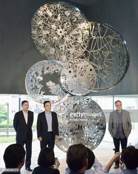 Nissan Motor Co Chairman Carlos Ghosn attends a ceremony in Yokohama near Tokyo on June 22 where a sculpture to celebrate the automaker's comeback...