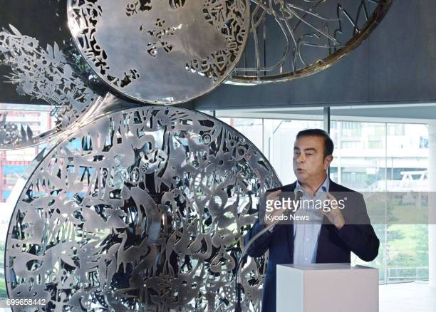 Nissan Motor Co Chairman Carlos Ghosn makes a speech in Yokohama near Tokyo on June 22 after unveiling a sculpture to celebrate the automaker's...