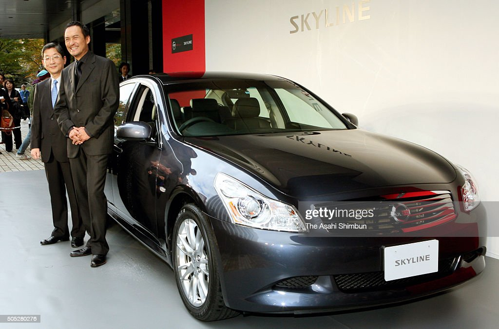 Nissan Motor Co COO Toshiyuki Shiga and actor ken Watanabe stand next to the new 'Skyline' at the company headquarters on November 20 2006 in Tokyo...