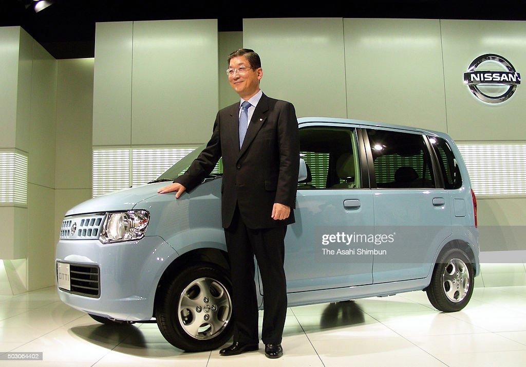 Nissan Motor Co COO Toshiyuki Shiga introduces new mini car 'Otti' at the company headquarters on October 3 2006 in Tokyo Japan
