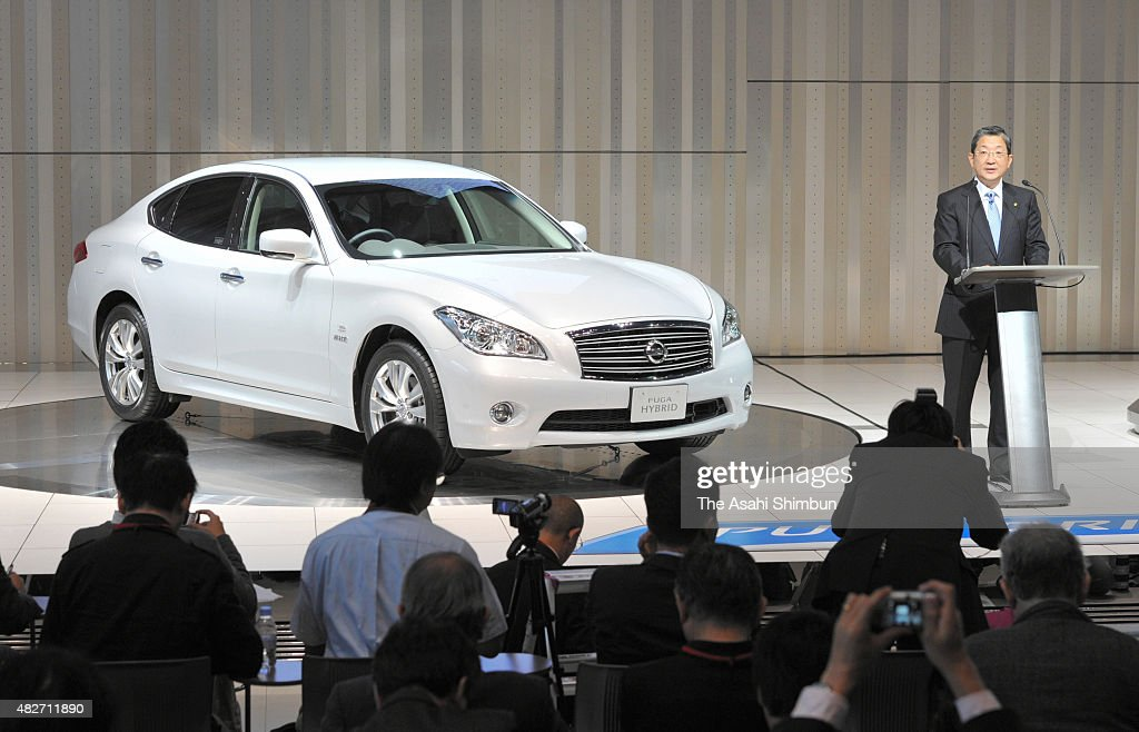 Nissan Motor Co COO Toshiyuki Shiga introduces the new Fuga Hybrid during a press conference at the company headquarters on October 26 2010 in...