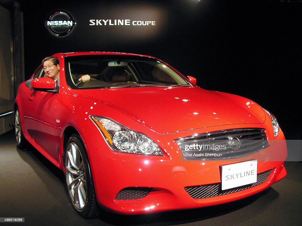 Nissan Motor Co COO Toshiyuki Shiga on the driving seat of the new 'Skyline Coupe' during its unveiling on October 2 2007 in Tokyo Japan