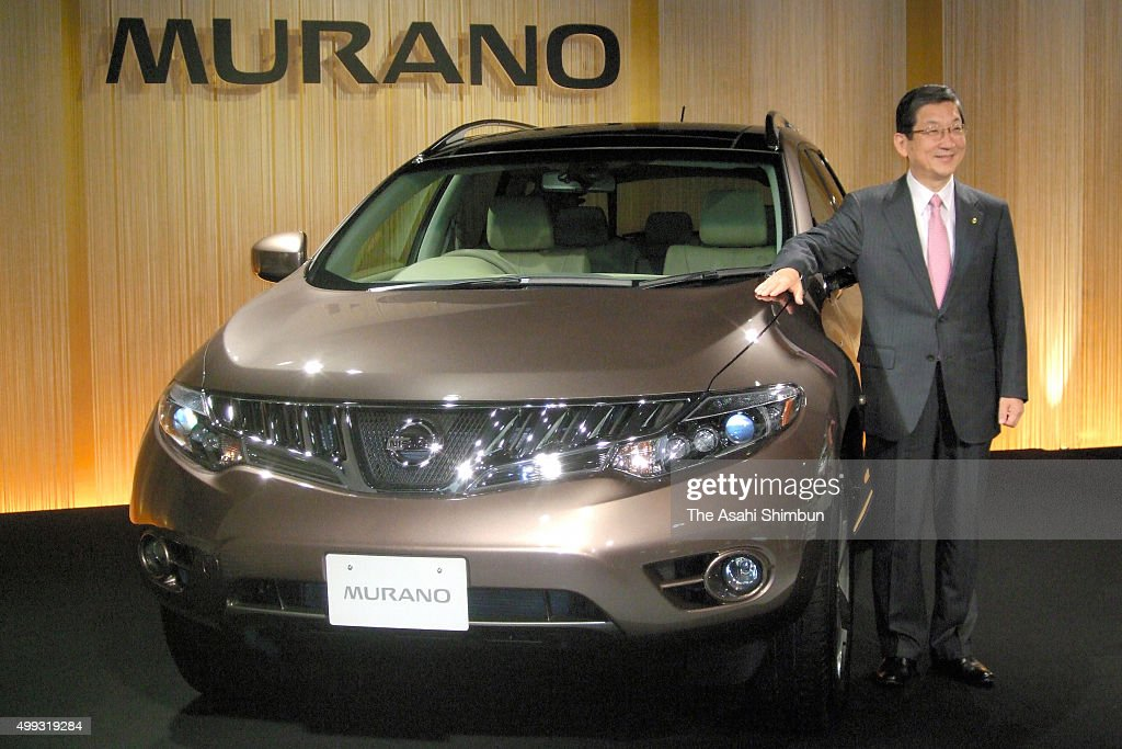 Nissan Motor Co COO Toshiyuki Shiga poses for photographs with the new SUV Murano during its unveiling on September 30 2007 in Tokyo Japan