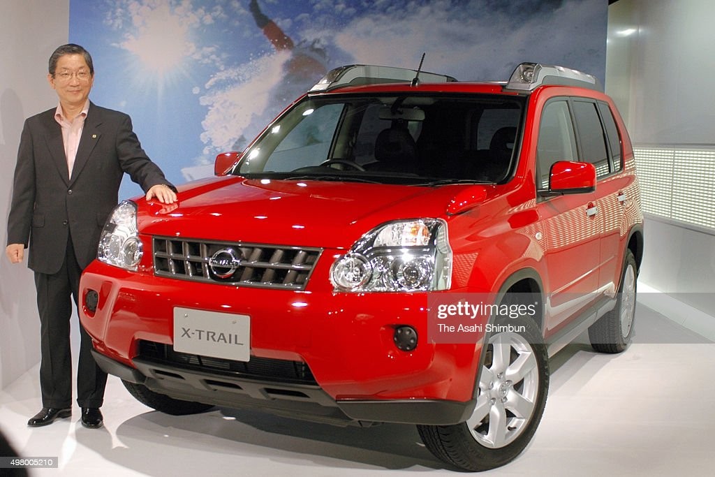 Nissan Motor Co COO Toshiyuki Shiga poses with new SUV 'XTrail' during its unveiling at the company headquarters on August 22 2007 in Tokyo Japan