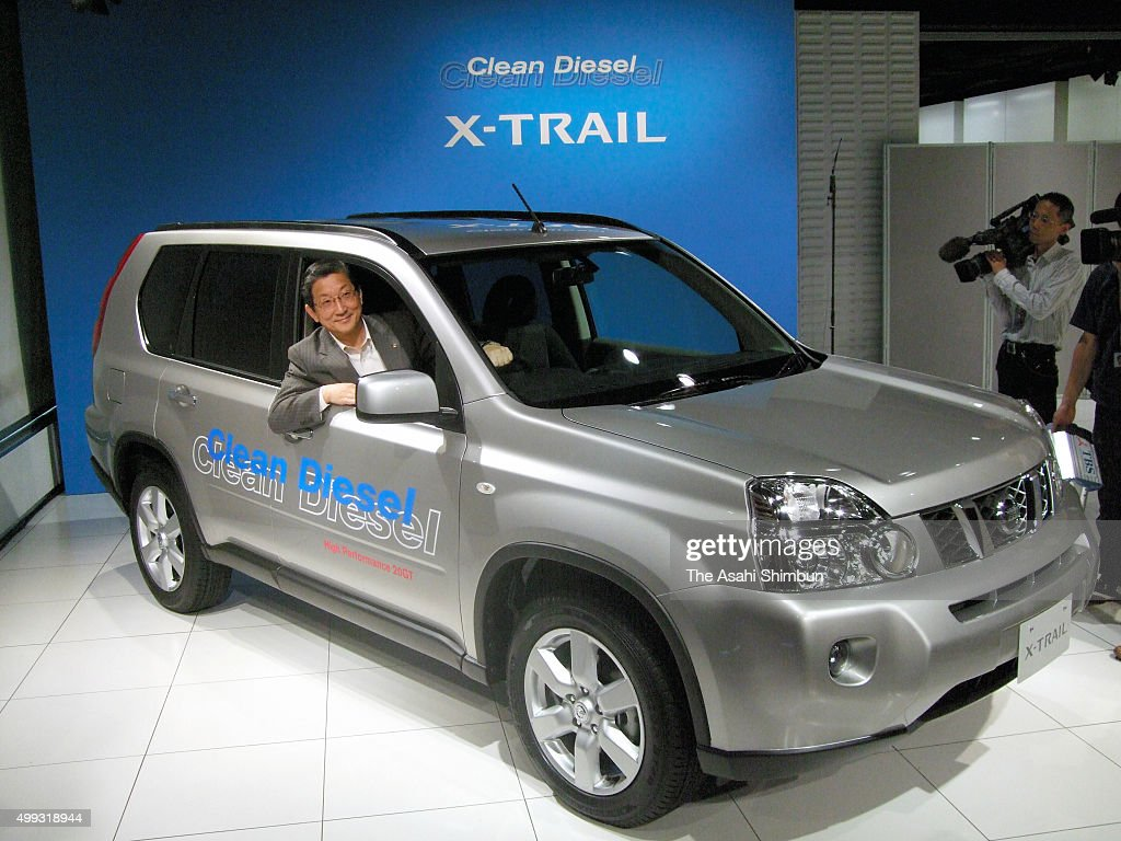 Nissan Motor Co COO Toshiyuki Shiga poses with the new XTrail 20GT during its unveiling on September 5 2007 in Tokyo Japan