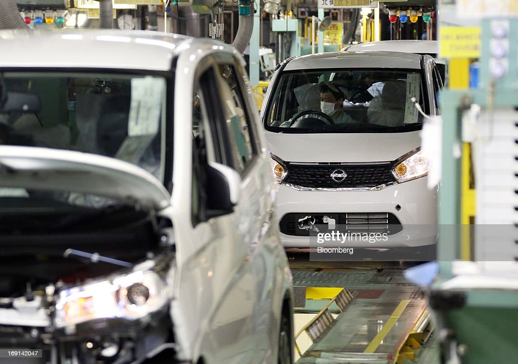 Nissan Motor Co. DAYZ minicars go through the inspection area on the production line of the Mitsubishi Motors Corp. Mizushima plant in Kurashiki City, Okayama Prefecture, Japan, on Monday, May 20, 2013. Nissan will start selling the first minicar it jointly developed with Mitsubishi Motors in Japan next month amid increasing demand from the nation's consumers for smaller and cheaper vehicles. Photographer: Tomohiro Ohsumi/Bloomberg via Getty Images