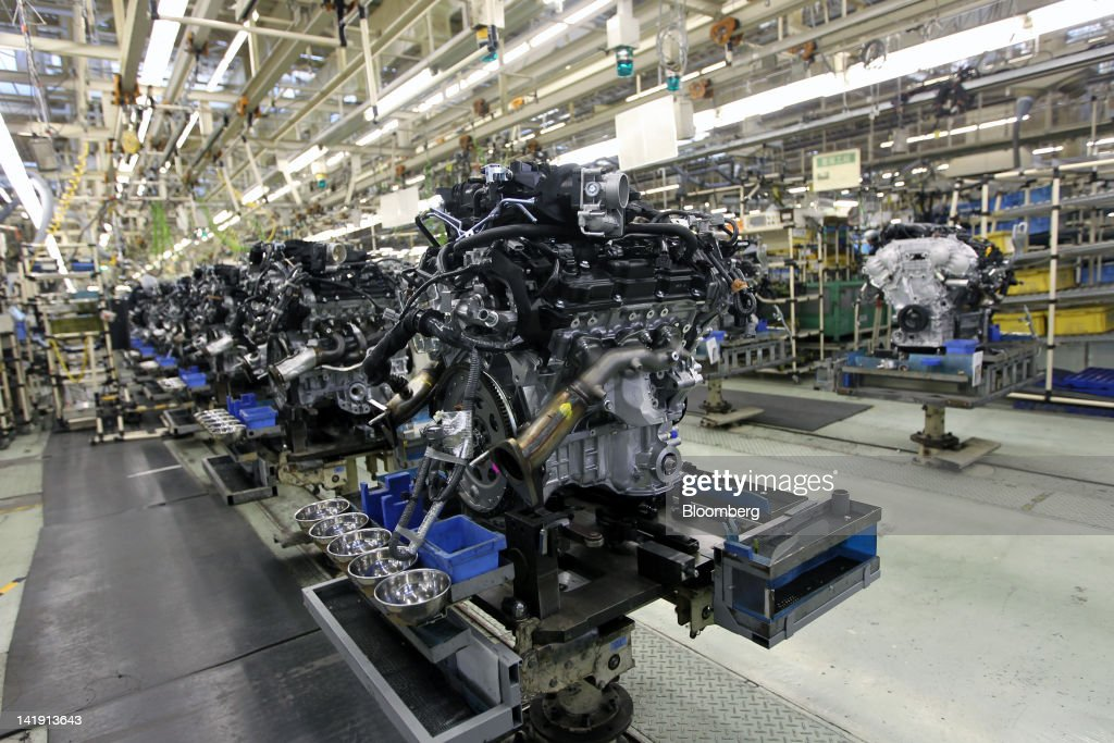 Nissan ceo carlos ghosn tours the company 39 s engine plant for Marketing strategy of nissan motor company