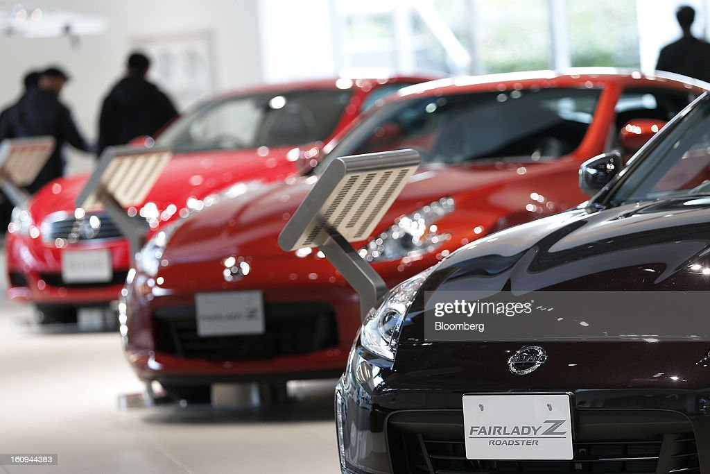 A Nissan Motor Co. Fairlady Z Roadster vehicle, right, sits on display with other vehicles at the company's showroom in Yokohama, Kanagawa Prefecture, Japan, on Friday, Feb. 8, 2013. Nissan, Japan's second-biggest carmaker, reported third-quarter profit that fell short of analysts' estimates, after sales tumbled in China and new models trailed competitors in the U.S. Photographer: Kiyoshi Ota/Bloomberg via Getty Images