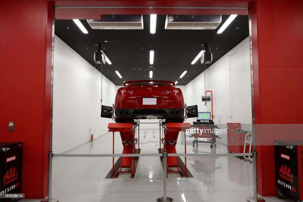 A Nissan Motor Co. GT-R Nismo vehicle sits in the repair shop at the Nismo global headquarters and development center in Yokohama City, Japan, on Tuesday, Feb. 26, 2013. Chief Executive Officer Carlos Ghosn, who has called 100 yen to the dollar the 'neutral' value for the Japanese currency, said the yen should weaken further. Photographer: Akio Kon/Bloomberg via Getty Images