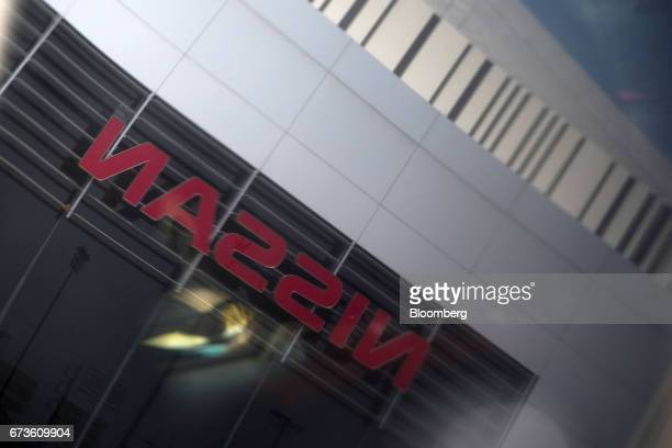A Nissan Motor Co logo is reflected on a window outside the company's plant in Samut Prakan Thailand on Tuesday April 25 2017 Nissan andMitsubishi...