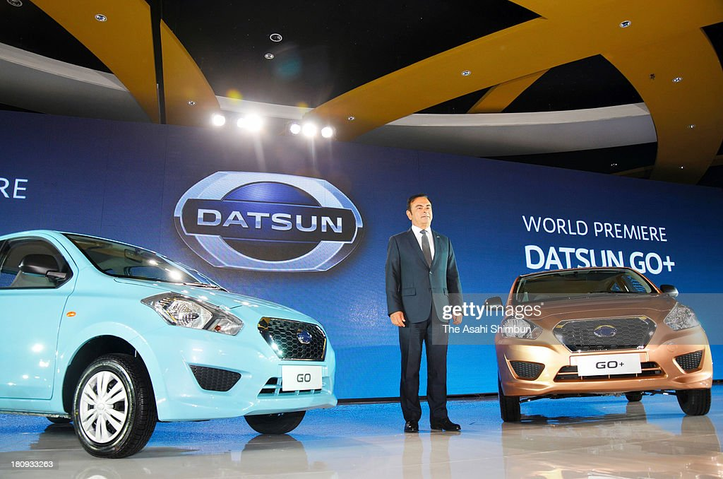 Nissan Motor Co President and CEO Carlos Ghosn poses with 'Go' and 'Go+' at their launching on September 17, 2013 in Jakarta, Indonesia. Nissan will launch low price cars in India, Indonesia and South Africa to meet demands of the emerging market under 'Datsun' brand.