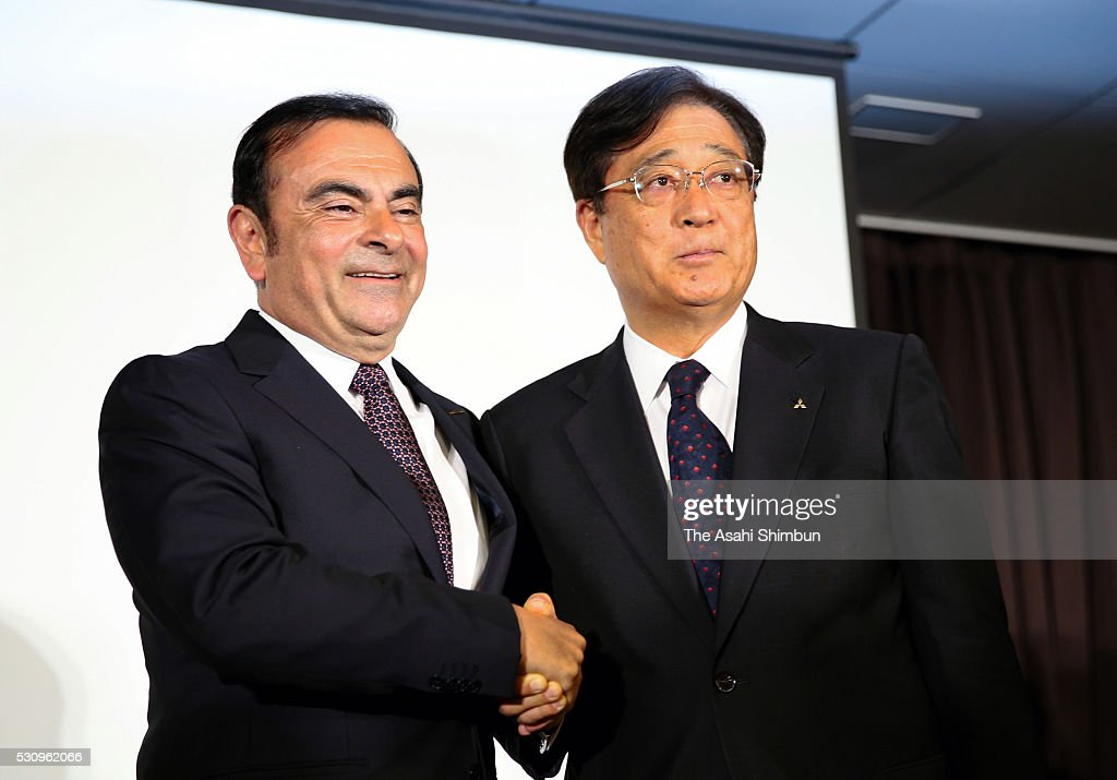Nissan Motor Co President <a gi-track='captionPersonalityLinkClicked' href=/galleries/search?phrase=Carlos+Ghosn&family=editorial&specificpeople=215025 ng-click='$event.stopPropagation()'>Carlos Ghosn</a> (L) and Mitsubishi Motors Chairman Osamu Masuko (R) shake hands during a joint press conference at TKP Garden City Yokohama on May 12, 2016 in Yokohama, Kanagawa, Japan. Nissan will take 34 percent stake in troubled Mitsubishi Motors, for 237 billion Japanese yen (approximately 2.2 million U.S. dollars) and become the top shareholder in the automaker, which has been troubled by fuel economy scandal.