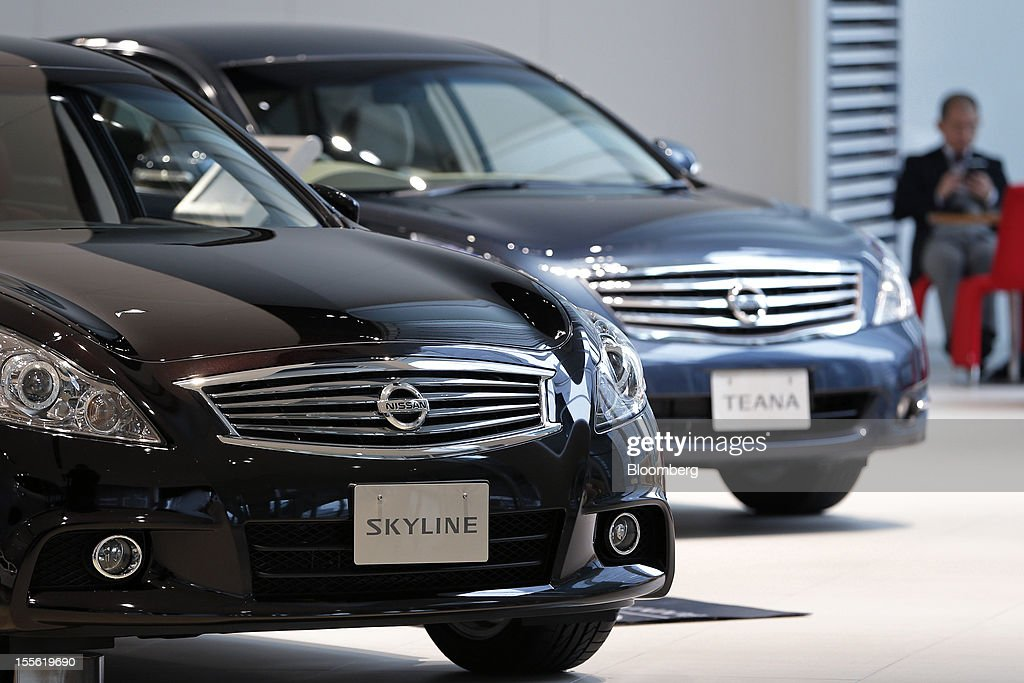 A Nissan Motor Co. Skyline, left, and a Teana vehicle are displayed at the company's headquarters in Yokohama City, Kanagawa Prefecture, Japan, on Tuesday, Nov. 6, 2012. Nissan, the top Japanese seller of vehicles in China, cut its full-year net income forecast 20 percent after consumer backlash stemming from a territorial dispute sent sales lower in its largest market. Photographer: Kiyoshi Ota/Bloomberg via Getty Images