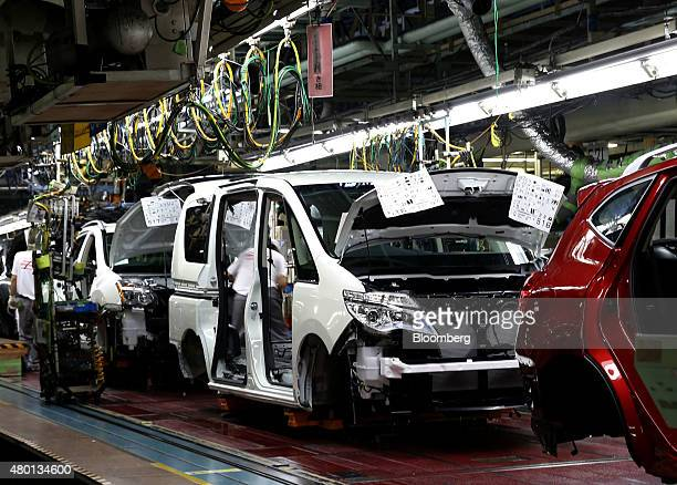 Nissan Motor Co vehicles move on the production line of the company's Kyushu plant in Kanda Town Fukuoka Prefecture Japan on Thursday July 9 2015...