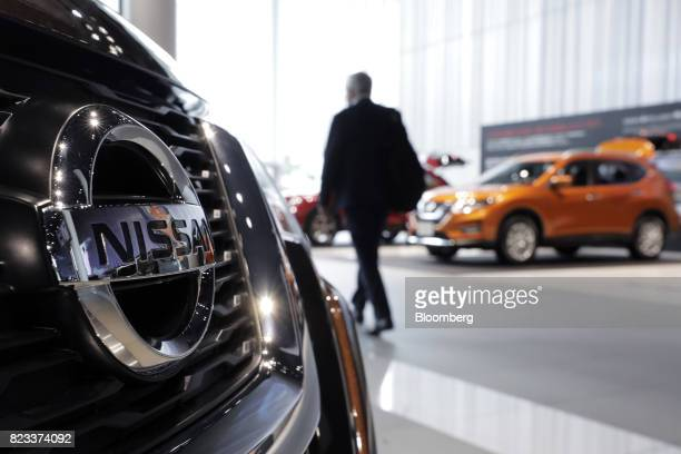 A Nissan Motor Co XTrail vehicle left is displayed at the company's showroom in Yokohama Japan on Thursday July 27 2017 Nissan is counting on SUV...