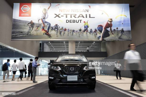 A Nissan Motor Co XTrail vehicle stands on display outside the company's showroom in Yokohama Japan on Thursday July 27 2017 Nissan is counting on...