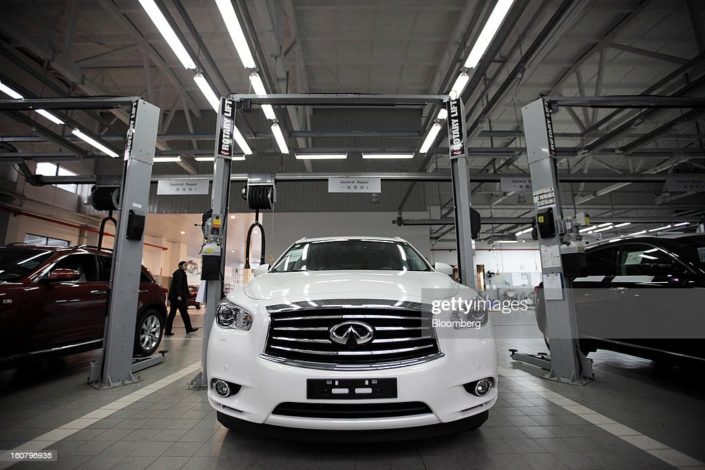 A Nissan Motor Co.'s Infiniti brand vehicle is parked inside the repair area at a Shanghai Dongchang Infiniti Auto Sales and Service Co. dealership in Shanghai, China, on Tuesday, Feb. 5, 2013. Nissan moved Infiniti's global headquarters to Hong Kong last May and plans to produce vehicles in China in 2014. Photographer: Tomohiro Ohsumi/Bloomberg via Getty Images