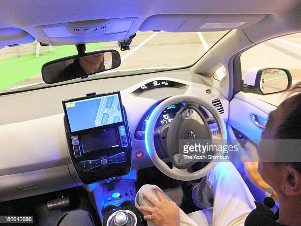 Nissan Motor Co's selfdriving car starts to turn at an intersection during the CEATEC Japan 2013 at Makuhari Messe on October 1 2013 in Chiba Japan...