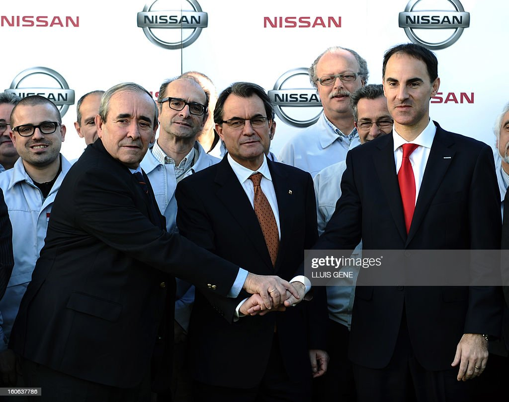 Nissan Motor Iberica's Chief Executive Officer (CEO) Frank Torres (R) and President of the Catalan regional government and leader of the Catalan party CIU (Convergence and Unity party) Artur Mas (C) and Spanish secretary general for industry Luis Valero pose at Nissan's factory in Barcelona on February 4, 2013. Nissan will make a new car model at its Barcelona factory, which will create 1,000 jobs and bring in around130 million euros (178 million USD) of new investment, Spanish media reported.