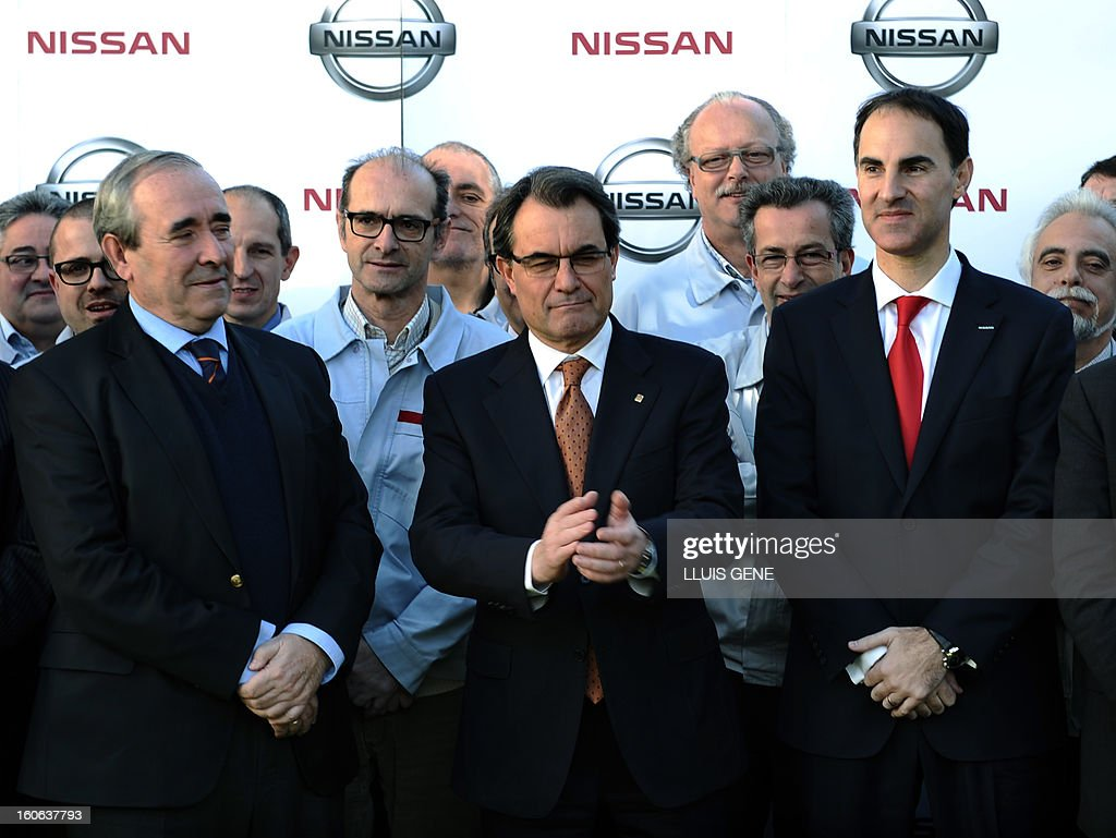 Nissan Motor Iberica's Chief Executive Officer (CEO) Frank Torres (R) and President of the Catalan regional government and leader of the Catalan party CIU (Convergence and Unity party) Artur Mas (C) and Spanish secretary general for industry Luis Valero pose at Nissan's factory in Barcelona on February 4, 2013. Nissan will make a new car model at its Barcelona factory, which will create 1,000 jobs and bring in around130 million euros (178 million USD) of new investment, Spanish media reported. AFP PHOTO / LLUIS GENE