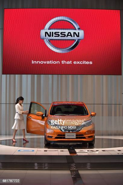 A Nissan Motor's latest car is displayed at a showroom at Nissan Global Headquarters in Yokohama Kanagawa prefecture on May 11 2017 Nissan warned on...