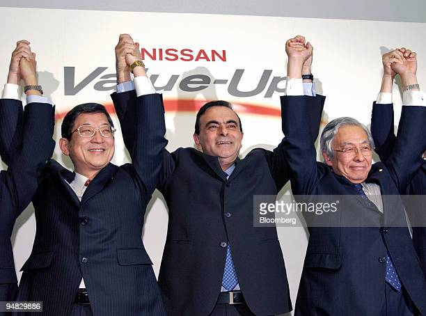 Nissan Motors Senior Vice President Toshiyuki Shiga left Chief Executive Officer Carlos Ghosn center and Executive Vice President Itaru Koeda right...