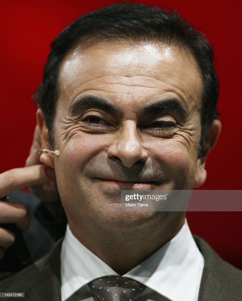 Nissan President and CEO Carlos Ghosn has a microphone adjusted after introducing the new 2013 Nissan Altima at the New York International Auto Show...