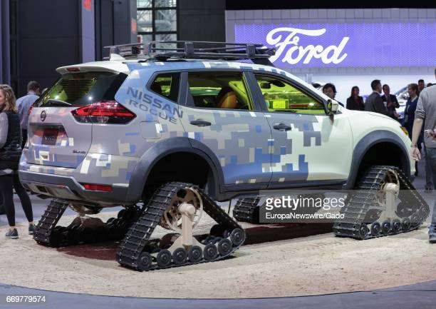 Nissan Rogue outfitted with tank treads during 2017 New York International Auto Show Press Day at Jacob K Javits Convention Center in New York City...