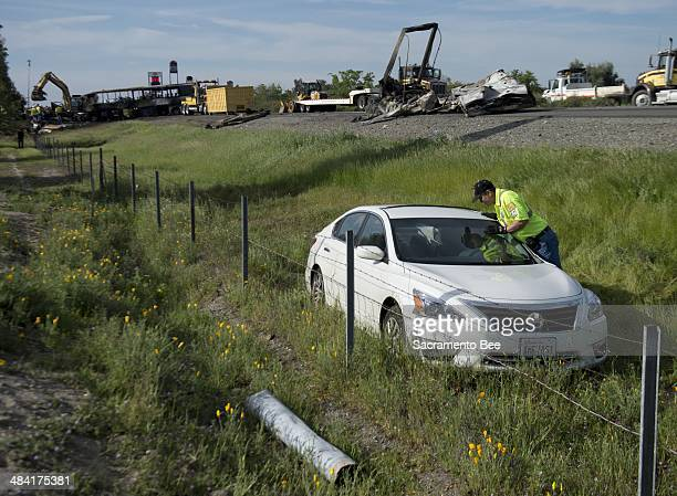 A Nissan sedan involved in the accident of a FedEx tractor trailer and bus that collided on Interstate 5 Thursday is prepared for removal on Friday...