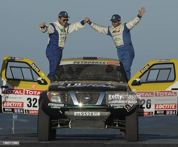 Nissan's driver Jean De Azevedo and codriver Emerson Cavassin from Brazil pose on the podium during the symbolic start of the 2012 Dakar Rally in Mar...