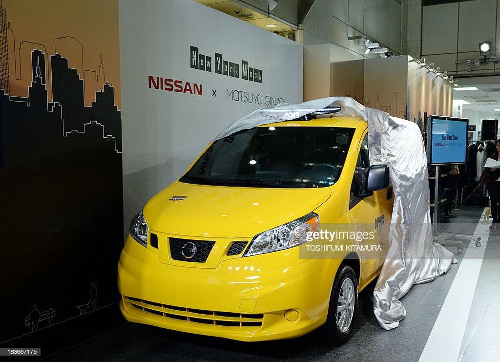 Nissan's NV200, 'New York taxi of tomorrow' is unveiled during its press preview in Tokyo on October 9, 2013. Nissan displays a production model of New York city's next-generation yellow cab at the Matsuya Ginza department store during the store's one-week-long New York week fair. AFP PHOTO / TOSHIFUMI KITAMURA