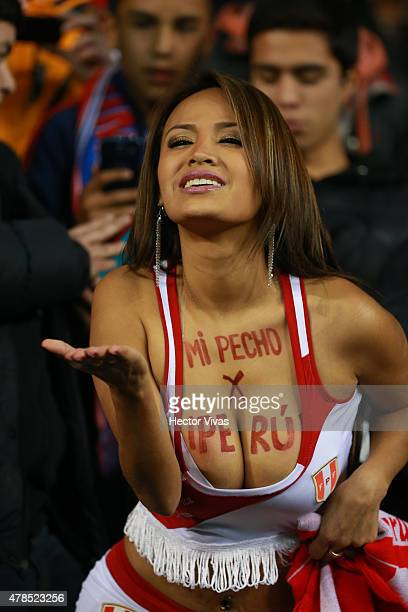 Nissu Cauti fan of Peru blows a kiss prior the 2015 Copa America Chile quarter final match between Peru and Bolivia at German Becker Stadium on June...