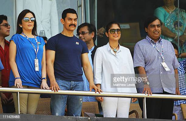 Nita Ambani Actor Aamir Khan Actress Preity Zinta and Mukesh Ambani watch from the stands during the 2011 ICC World Cup Final between India and Sri...