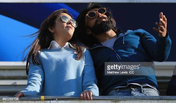 Nita Ambani and Bollywood actor Ranveer Singh watch from the stands during the ICC Champions Trophy match between India and Pakistan at Edgbaston on...