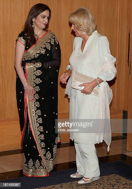Nita Ambani and Camilla Duchess of Cornwall chat at the British Asian Trust Reception on day 4 of an official visit to India on November 9 2013 in...