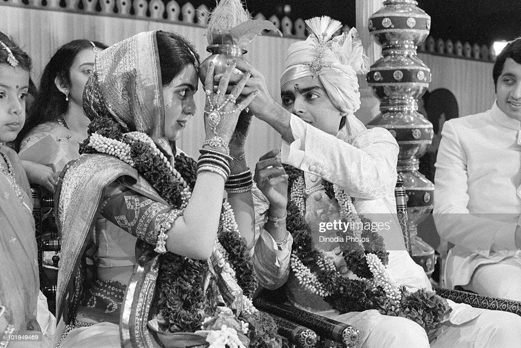 Nita Ambani and Indian billionaire industrialist <a gi-track='captionPersonalityLinkClicked' href=/galleries/search?phrase=Mukesh+Ambani&family=editorial&specificpeople=552252 ng-click='$event.stopPropagation()'>Mukesh Ambani</a> at their wedding ceremony, Mumbai, circa 1985.